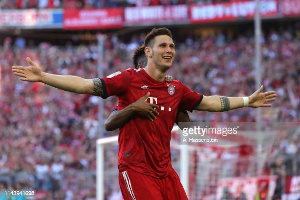 Niklas Suele of Bayern Muenchen celebrates scoring the opening goal during the Bundesliga match between FC Bayern Muenchen and SV Werder Bremen at...