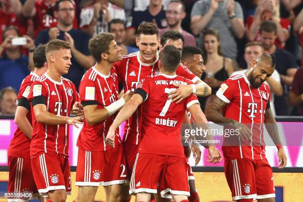 Niklas Suele of Bayern Muenchen celebrates scoring the opening goal during the Bundesliga match between FC Bayern Muenchen and Bayer 04 Leverkusen at...
