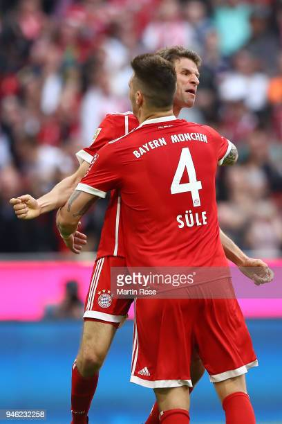 Niklas Suele of Bayern Muenchen celebrates with Thomas Mueller of Bayern Muenchen after Sandro Wagner of Muenchen scored a goal to make it 11 during...