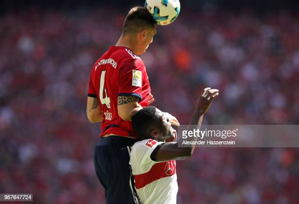 Niklas Suele of Bayern Muenchen competes for a header with Orel Mangala of Stuttgart during the Bundesliga match between FC Bayern Muenchen and VfB...