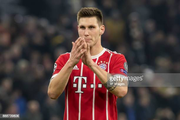 Niklas Suele of Bayern Muenchen gestures during the UEFA Champions League group B match between Bayern Muenchen and Paris SaintGermain at Allianz...