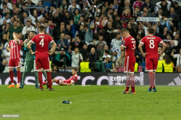 Niklas Suele of Bayern Muenchen Joshua Kimmich of Bayern Muenchen and Javi Martinez of Bayern Muenchen disappointed after the UEFA Champions League...