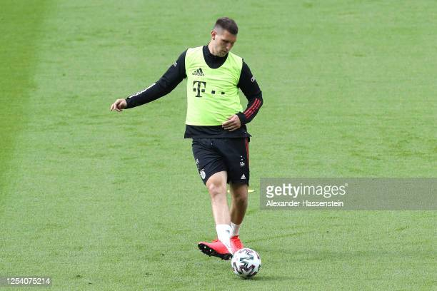 Niklas Suele of Bayern Muenchen plays the ball during a FC Bayern Muenchen training session ahead of DFB Cup 2020 final match against Bayer 04...