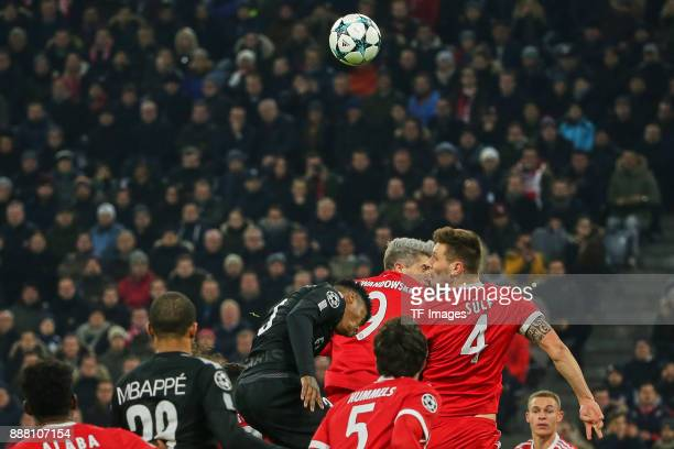 Niklas Suele of Bayern Muenchen Robert Lewandowski of Bayern Muenchen and Presnel Kimpembe of Paris SaintGermain battle for the ball during the UEFA...
