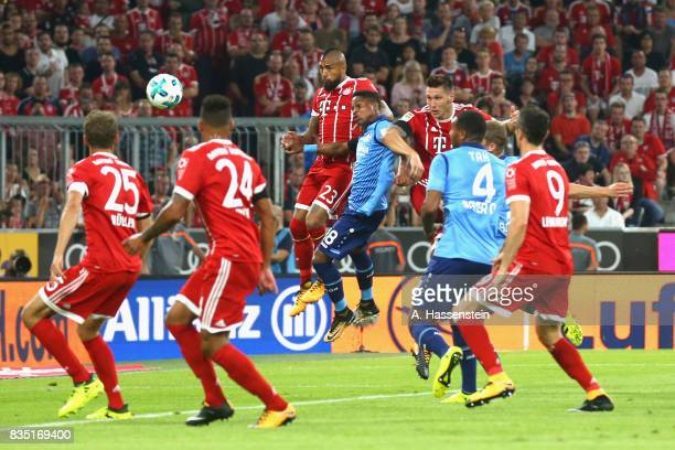 Niklas Suele of Bayern Muenchen scores the opening goal during the Bundesliga match between FC Bayern Muenchen and Bayer 04 Leverkusen at Allianz...