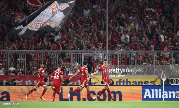 Niklas Suele of Bayern Munich celebrates after he scored the first goal of the match and the season with his team mates during the Bundesliga match...
