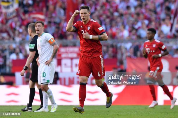 Niklas Suele of Bayern Munich celebrates after scoring his team's first goal during the Bundesliga match between FC Bayern Muenchen and SV Werder...