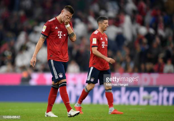 Niklas Suele of Bayern Munich looks dejected following his sides defeat in the Bundesliga match between FC Bayern Muenchen and Borussia...