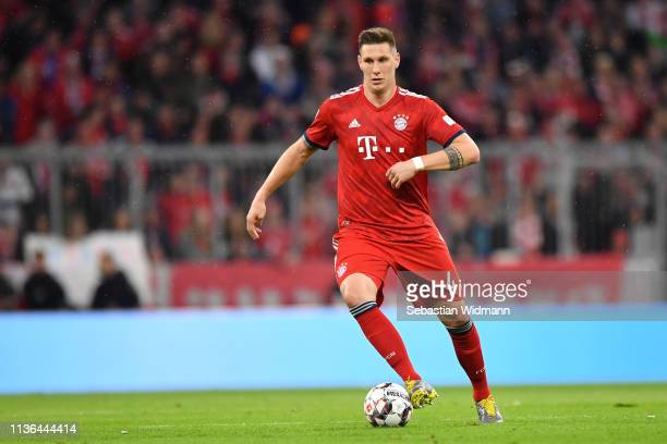 Niklas Suele of Bayern Munich plays the ball during the Bundesliga match between FC Bayern Muenchen and 1 FSV Mainz 05 at Allianz Arena on March 17...
