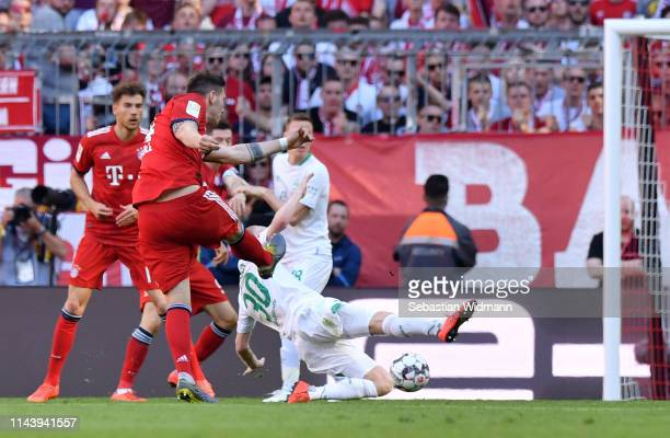 Niklas Suele of Bayern Munich scores his team's first goal during the Bundesliga match between FC Bayern Muenchen and SV Werder Bremen at Allianz...