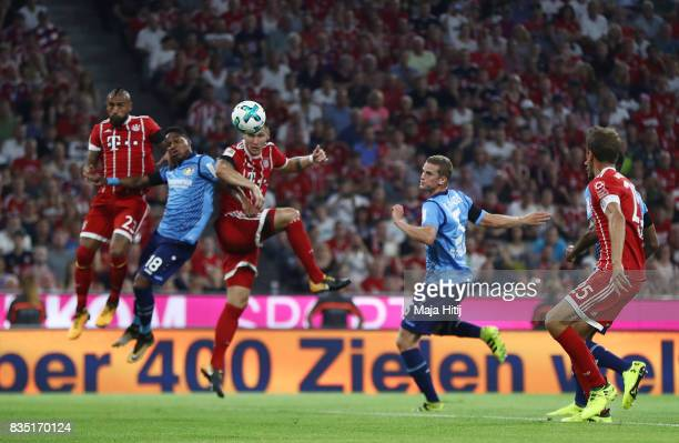 Niklas Suele of Bayern Munich scores the first goal of the match and the season during the Bundesliga match between FC Bayern Muenchen and Bayer 04...