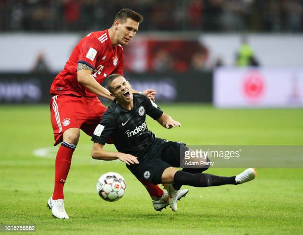 Niklas Suele of Bayern Munich tackles Mijat Gacinovic of Eintracht Frankfurt during the DFL Supercup 2018 match between Eintracht Frankfurt and...