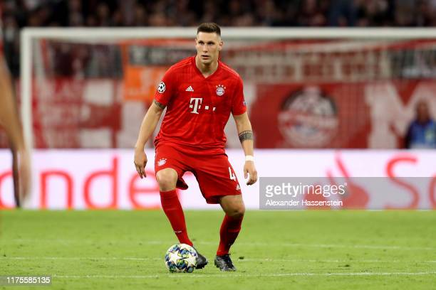 Niklas Suele of FC Bayern Muenchen runs with the ball during the UEFA Champions League group B match between Bayern Muenchen and Crvena Zvezda at...
