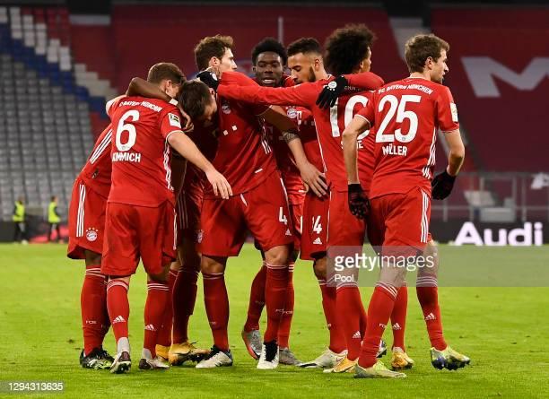 Niklas Suele of FC Bayern Munich celebrates with team mates after scoring their sides third goal during the Bundesliga match between FC Bayern...