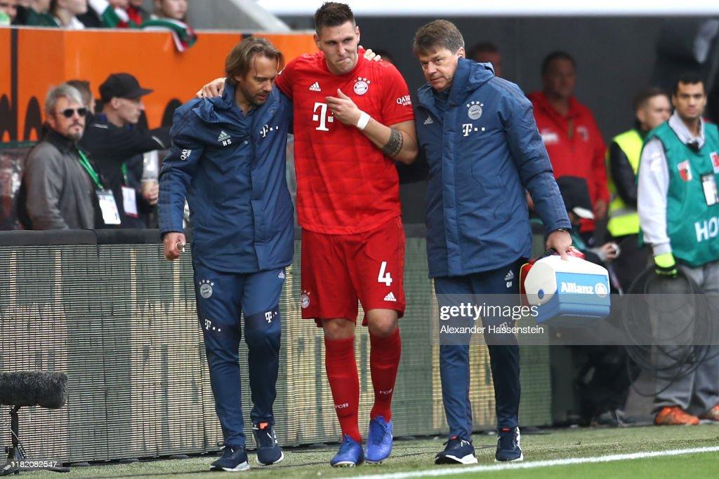 Niklas Suele of FC Bayern Munich receives medical treatment during ...