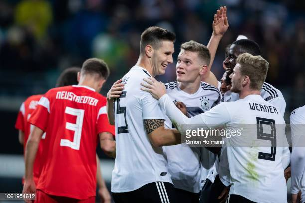 Niklas Suele of Germany celebrates his team's second goal with his team mates Matthias Ginter Antonio Ruediger and Timo Werner of Germany during the...