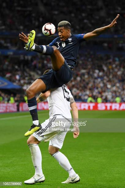 Niklas Suele of Germany collides with Presnel Kimpembe of France during the UEFA Nations League A group one match between France and Germany at Stade...