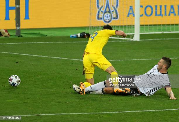 Niklas Suele of Germany fouls Roman Yaremchuk of Ukraine for a penalty during the UEFA Nations League group stage match between Ukraine and Germany...
