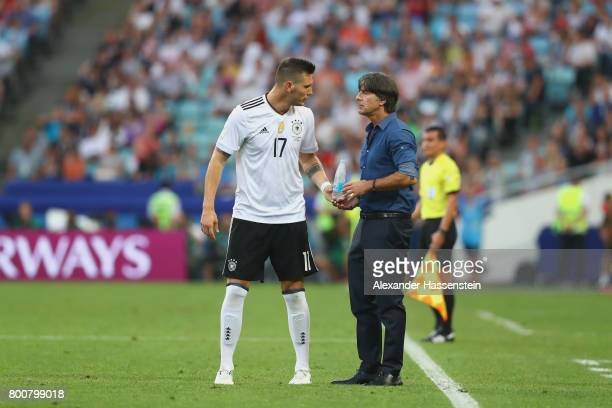 Niklas Suele of Germany talks to head coach Joachim Loew during the FIFA Confederations Cup Russia 2017 Group B match between Germany and Cameroon at...