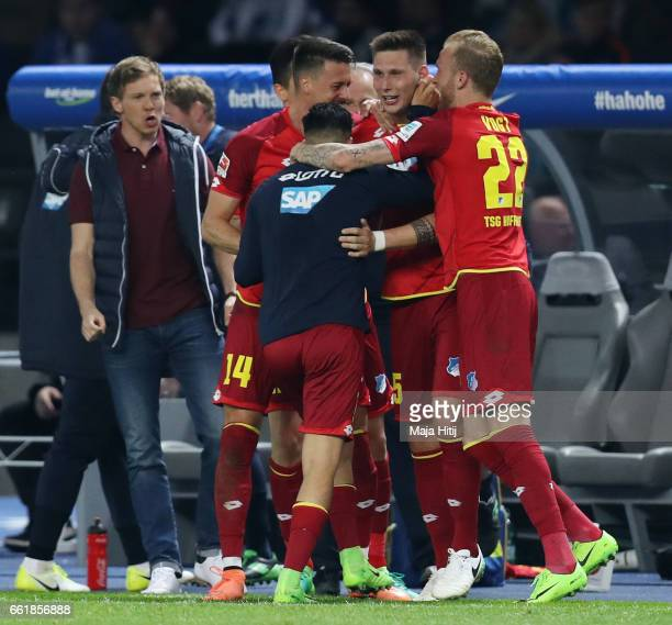 Niklas Suele of Hoffenheim celebrates his team's second goal with team mates during the Bundesliga match between Hertha BSC and TSG 1899 Hoffenheim...