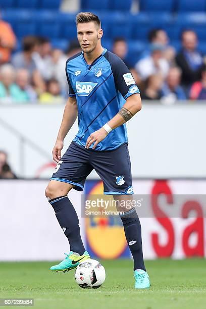 Niklas Suele of Hoffenheim controls the ball during the Bundesliga match between TSG 1899 Hoffenheim and VfL Wolfsburg at Wirsol RheinNeckarArena on...