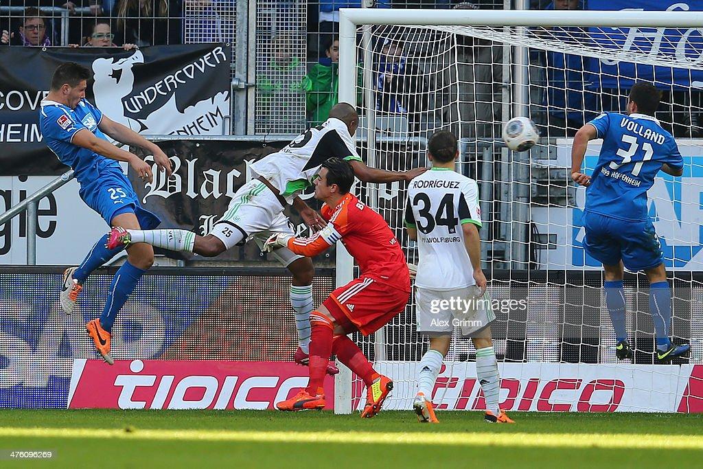 Niklas Suele of Hoffenheim scores his team's second goal against Naldo, goalkeeper Diego Benaglio and Ricardo Rodriguez (L-2R) of Wolfsburg during the Bundesliga match between 1899 Hoffenheim and VfL Wolfsburg at Wirsol Rhein-Neckar-Arena on March 2, 2014 in Sinsheim, Germany.