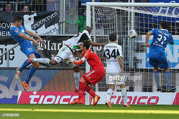 Niklas Suele of Hoffenheim scores his team's second goal against Naldo goalkeeper Diego Benaglio and Ricardo Rodriguez of Wolfsburg during the...