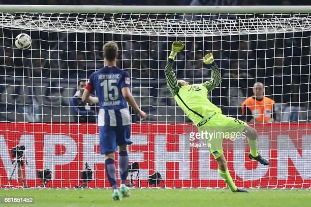 Niklas Suele of Hoffenheim scores his team's second goal past goalkeeper Rune Jarstein of Berlinduring the Bundesliga match between Hertha BSC and...
