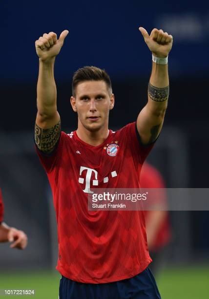Niklas Suele of Muenchen celebrates during the friendly match between Hamburger SV and Bayern Muenchen at Volksparkstadion on August 15 2018 in...