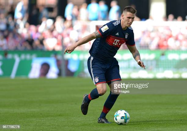 Niklas Suele of Muenchen controls the ball during the Bundesliga match between 1 FC Koeln and FC Bayern Muenchen at RheinEnergieStadion on May 5 2018...
