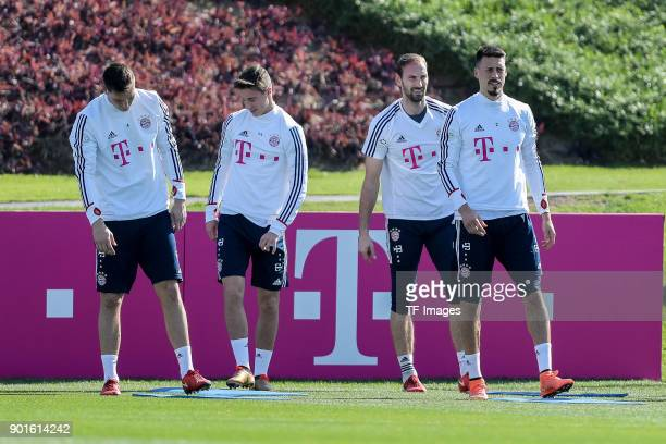 Niklas Suele of Muenchen Marco Friedl of Muenchen Goalkeeper Tom Starke of Muenchen and Sandro Wagner of Muenchen look on during the FC Bayern...