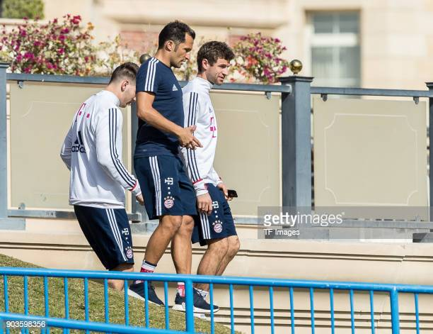 Niklas Suele of Muenchen Sporting director Hasan Salihamidzic of Muenchen and Thomas Mueller of Muenchen walk during the FC Bayern Muenchen training...