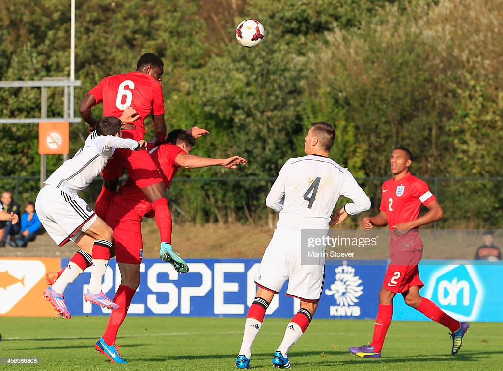 Niklas Suele of U20 Germany challenges Kwame Thomas of U20 England during the match between U20 Germany v U20 England at Sportpark Skoatterwald on October 9, 2014 in Heerenveen, Netherlands.