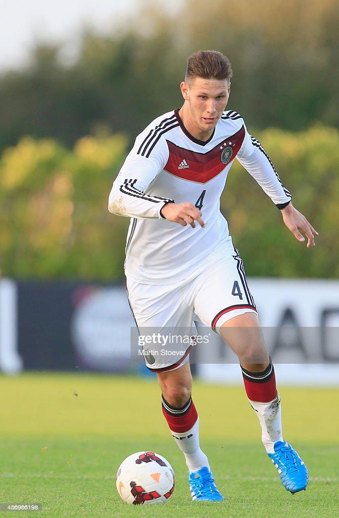 Niklas Suele of U20 Germany plays the ball during the match between U20 Germany v U20 England at Sportpark Skoatterwald on October 9, 2014 in Heerenveen, Netherlands.