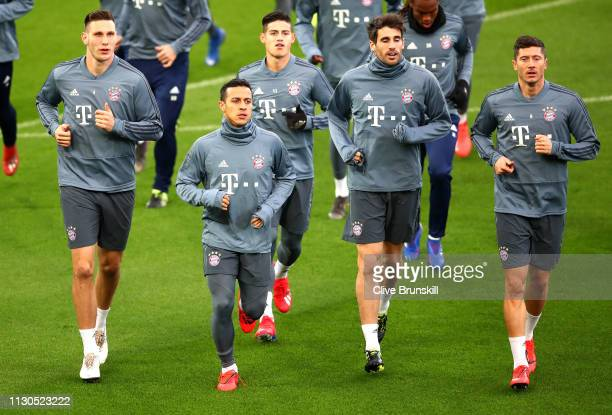 Niklas Suele Thiago Alcantara James Rodriguez Javier Martinez and Robert Lewandowski of Bayern Munich all warm up during the FC Bayern Muenchen...