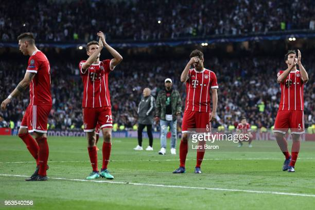 Niklas Suele Thomas Mueller Javi Martinez and Mats Hummels of Bayern Muenchen look dejected as they fail to reach the final after the UEFA Champions...
