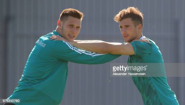Niklas Suele warms up with team mate Leon Goretzka during the Germany Training And Press Conference at Sport Base Vatutinki on June 15 2018 in Moscow...