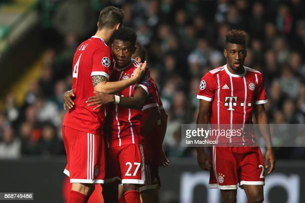Niklas Sule and David Alaba celebrate a goal from Javi Martinez of Bayern Muenchen during the UEFA Champions League group B match between Celtic FC...
