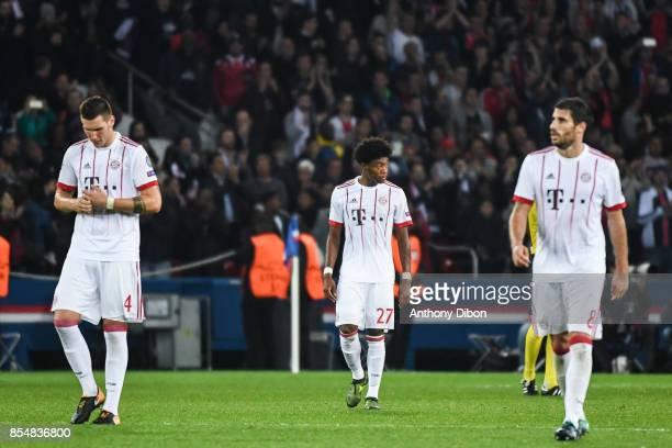 Niklas Sule David Alaba and Javi Martinez of Bayern Munich looks dejected during the Uefa Champions League match between Paris Saint Germain and Fc...