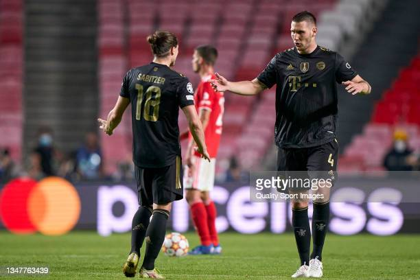 Niklas Sule of Bayern München talks with Marcel Sabiter of Bayern München during the UEFA Champions League group E match between SL Benfica and...