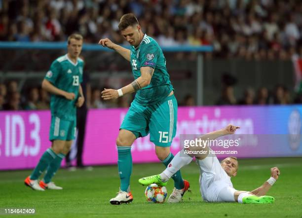 Niklas Sule of Germany is tackled by Denis Laptev of Belarus during the UEFA Euro 2020 qualifier match between Belarus and Germany at BorisovArena on...