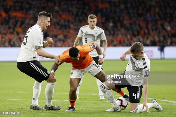 Niklas Sule of Germany Memphis Depay of Holland Toni Kroos of Germany Matthias Ginter of Germany during the UEFA EURO 2020 qualifier group C...
