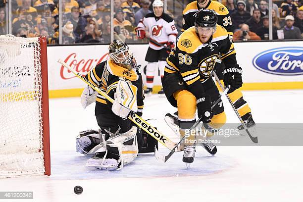 Niklas Svedberg and Kevan Miller of the Boston Bruins watch the loose puck against the New Jersey Devils at the TD Garden on January 8 2015 in Boston...