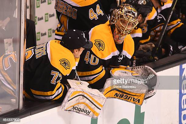 Niklas Svedberg and Tuukka Rask of the Boston Bruins chat during a timeout against the Vancouver Canucks at the TD Garden on February 24 2015 in...
