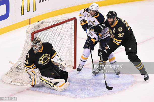 Niklas Svedberg and Zdeno Chara of the Boston Bruins watch the play against Matt Moulson of the Buffalo Sabres at the TD Garden on March 17 2015 in...