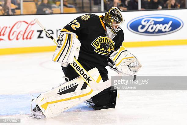 Niklas Svedberg of the Boston Bruins catches the puck against the Colorado Avalanche at the TD Garden on October 13 2014 in Boston Massachusetts
