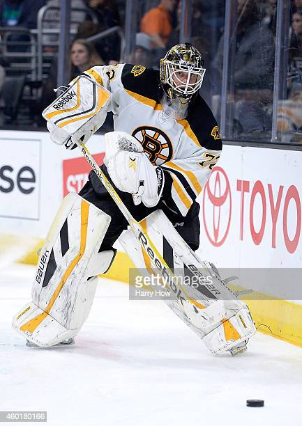 Niklas Svedberg of the Boston Bruins clears the puck against the Los Angeles Kings at Staples Center on December 2 2014 in Los Angeles California