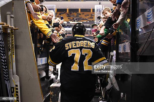 Niklas Svedberg of the Boston Bruins high fives fans before the game against the Buffalo Sabres at the TD Garden on December 21 2014 in Boston...