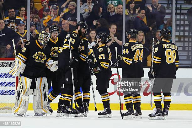 Niklas Svedberg of the Boston Bruins is congratulated by his teammates after they won their game against the Detroit Red Wings at TD Garden on March...