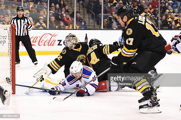 Niklas Svedberg of the Boston Bruins leans back to make a save against Jesper Fast of the New York Rangers at the TD Garden on March 28 2015 in...